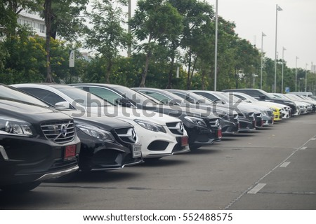 Bangkok, Thailand, January 6, 2017: Closeup of new luxury cars Mercedes-Benz c and e Volvo class parking in front of car store. Detail front view of cars.