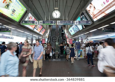 Bangkok, Thailand - January 18, 2016 : crowd of people at BTS Siam station some people waiting for the train and some people using the escalator that has advertising along the way in rush hour evening - stock photo