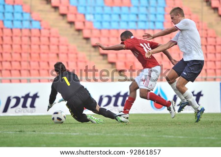 BANGKOK THAILAND - JANUARY 15 : M.Patrick (red) in action during KING'S CUP 2012 between Denmark vs Norway on January 15, 2012 in Rajamangla Stadium,Bangkok, Thailand.