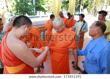 BANGKOK,THAILAND JANUARY 12 : Newly ordained Buddhist monk pray with priest procession. Newly ordained Buddhist monks have a ritual in the temple procession in Bangkok Thailand on January 12, 2014