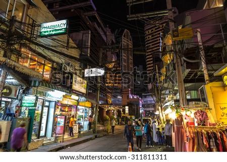 BANGKOK, THAILAND, JANUARY 14, 2015 : Night View in the messy Soi (street) 5 of the Sukhumvit road in the Nana district, Bangkok, Thailand - stock photo