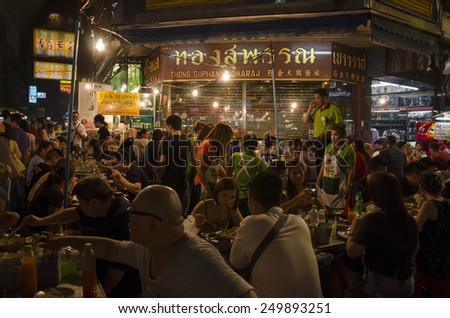Bangkok, Thailand - 31 January 2015 : People come to shopping at bangkok chinatown on Yaowarat Road,There are many small streets and alleys full of shops and vendors selling all types of goods. - stock photo