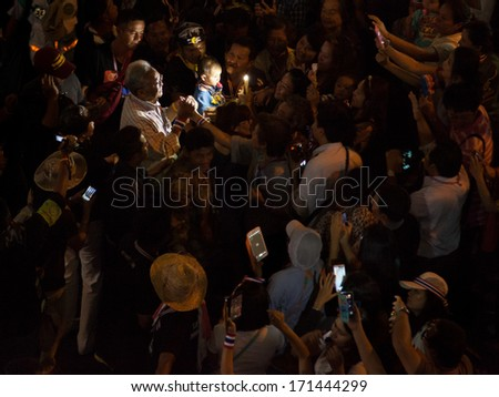 Bangkok, Thailand - January 15, 2014: People take photos with Thai protest leader Suthep Thaugsuban during his walk through Bangkok until night - stock photo