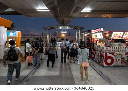 Bangkok, Thailand - January 18, 2016 : People waiting to go out of the BTS Mo Chit station at night because of some accident outside. Daily passengers of BTS skytrain is around 700,000. - stock photo