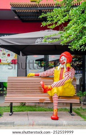 BANGKOK, THAILAND -january 31: Ronald McDonald character sitting on bench, in front of McDonalds restaurant at Thailand on january 31 2015