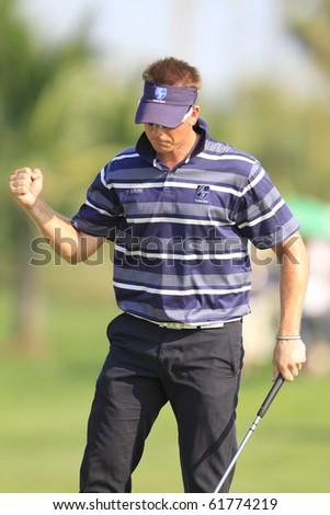 BANGKOK, THAILAND - JANUARY 10: Swedish golf player Henrik Stenson prepares for the last put at the Royal Trophy tournament, Asia vs Europe, at Amata Spring, Bangkok, Thailand on January 10, 2010 - stock photo