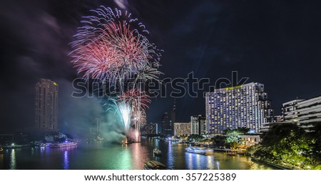 Bangkok, Thailand - 1 January 2016 : The fireworks celebrating year 2016 happening on the Chao Praya riverside which is one of the main landmark in Bangkok to celebrate this special occasion - stock photo