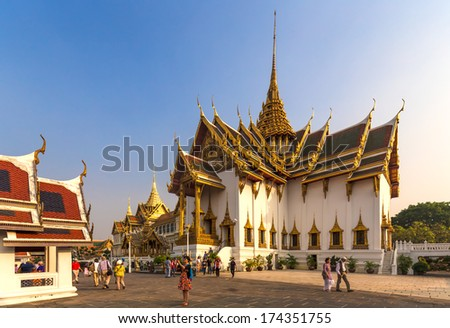 BANGKOK, THAILAND - JANUARY 2: Tourists visit the Grand Palace in Bangkok, Thailand on January 2, 2014. The Grand Palace has been the official residence of Thai kings since 1782.  - stock photo