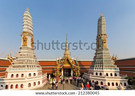BANGKOK, THAILAND - JANUARY 2, 2014: Tourists visit the Wat Phra Kaew temple and the Grand Palace in Bangkok, Thailand. The Grand Palace has been the official residence of Thai kings since 1782.  - stock photo