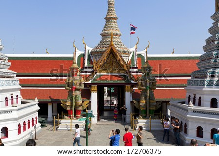 BANGKOK, THAILAND - JANUARY 10 : Unidentified tourists travel to Wat Phra Kaew and Grand Palace on January 10, 2014 in Bangkok, Thailand. Wat Phra Kaew is the most popular place for tourists to visit.
