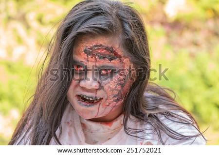 "BANGKOK,THAILAND - JANUARY 8, 2015: Unknown Thai girl participates in ""FOX Thai The Walking Dead Season 5 Marathon"" dressed as zombies - stock photo"