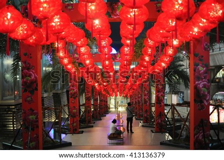 Bangkok, Thailand - January 22, 2011: View of red Chinese lanterns on display on a city centre street during celebrations of the Chinese New Year.
