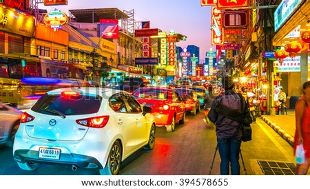 BANGKOK, THAILAND - JANUARY 26, 2016: View on people and traffic pass by in Chinatown on January 26, 2016 in Bangkok, Thailand.