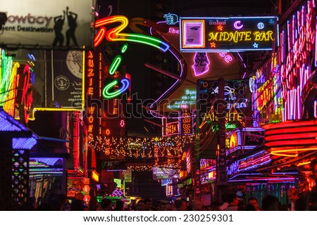 BANGKOK, THAILAND, JANUARY 31, 2012: View on the colorful neon lightings filling the Soi Cowboy street in the red entertainment district of Nana in Bangkok, Thailand - stock photo
