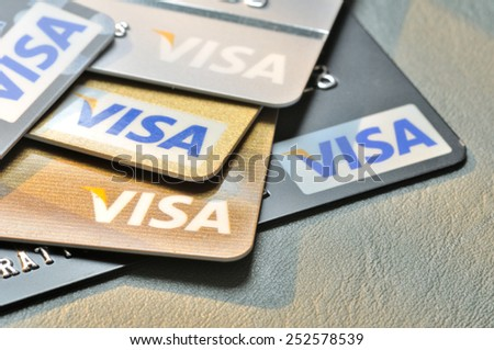 BANGKOK,THAILAND - January 28,2015:  Visa credit cards on leather board. - stock photo