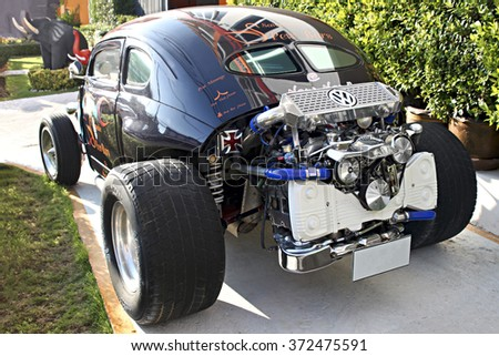 BANGKOK, THAILAND-JANUARY 11,2016:Volkswagen Beetle vintage car parked in a street of the city centre. Car exposed at tuning  with big and colored custom wheels - stock photo