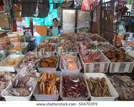 BANGKOK, THAILAND - JANUARY 20 : Woman in a market sells dried fish January 20, 2006 in Bangkok.