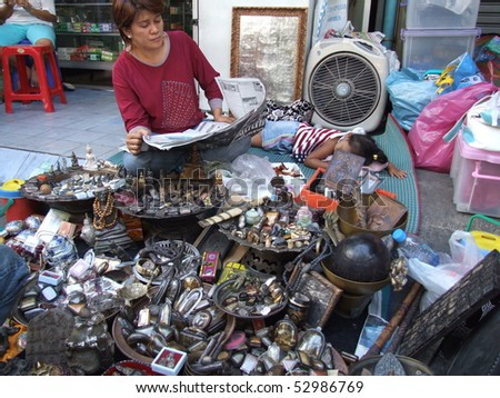BANGKOK, THAILAND - JANUARY 20 : Woman selling Buddhist ornaments in central Bangkok January 20, 2006 in Bangkok.