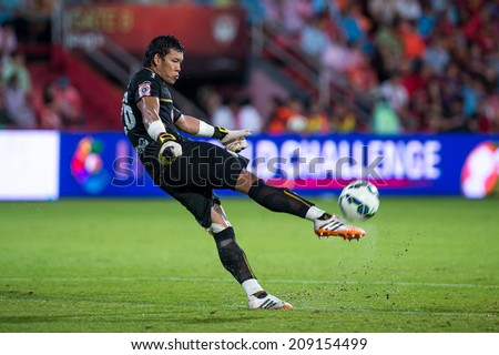 BANGKOK THAILAND-Jul30:Goalkeeper Kawin Thamsatchanan of Muangthong Utd.hit the ball during  the LFP World Challenge 2014 between SCG Muangthong UTD. and Almeria at SCG Stadium on July30,2014,Thailand - stock photo
