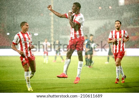BANGKOK THAILAND - Jul 30: Jonathan Zongo #19(L2) of UD Almeria celebrates during the LFP World Challenge 2014 between Muangthong UTD. and UD Almeria at SCG Stadium on July 30,2014 in Thailand.  - stock photo