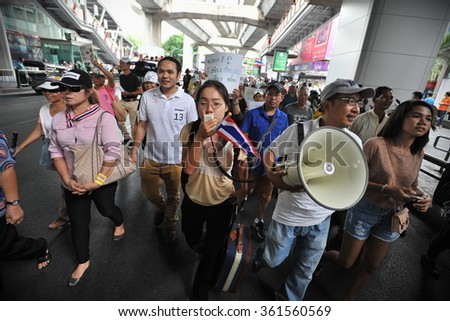 BANGKOK, THAILAND - JUL 21, 2013: Nationalist protesters march on a city centre street during an anti government rally. The protesters call for the government to be overthrown. - stock photo