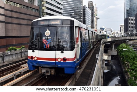 Bangkok, Thailand - July 4, 2016: A BTS Skytrain runs on elevated rails in the Thai capital's Sathorn district. Each train of the mass transport rail network can carry over 1,000 passengers.