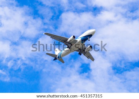 BANGKOK, THAILAND - JULY 4 : A flying airplane toward to Suvarnabhumi Airport on July 4,2016 in Ladkrabang, Bangkok, Thailand. With slightly cloud on clear sky