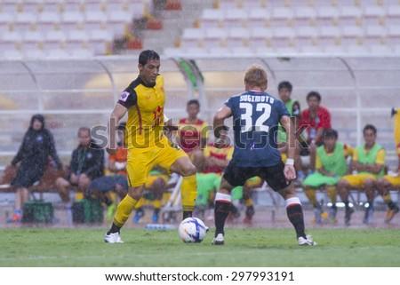 BANGKOK,THAILAND:JULY 2015:Addison(yellow)and Sukimoto poses during football Thai Premier League between Osotspa M150 and Chiang Rai United at Rajamangala National Stadium on July 19,2015inThailand.  - stock photo
