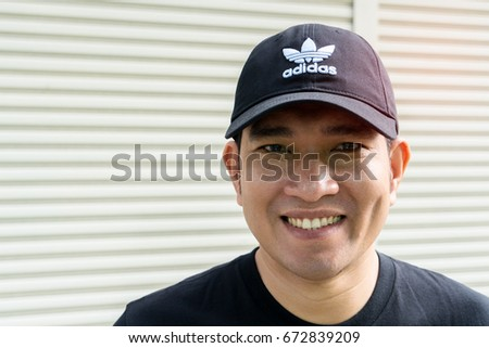 BANGKOK, THAILAND - JULY 2, 2017: Adidas logo on man cap. Adidas is German designer and manufacturer of sports clothing and accessories; largest in Europe and 2nd biggest in the world.