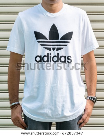 BANGKOK, THAILAND - JULY 2, 2017: Adidas logo on man T-shirt. Adidas is German designer and manufacturer of sports clothing and accessories; largest in Europe and 2nd biggest in the world.