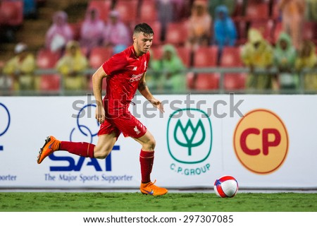 BANGKOK THAILAND JULY 14:Alberto Moreno  of Liverpool run with the ball during the international friendly match Thai All Stars and Liverpool FC at Rajamangala Stadium on July14,2015 in,Thailand. - stock photo