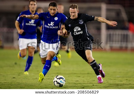 BANGKOK THAILAND JULY 27:Anthony Knockaert (L) of  Leicester City in action during the pre-season match between Leicester City and Everton at Supachalasai Stadium on July 27,2014 in Bangkok,Thailand.  - stock photo
