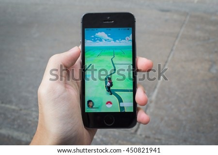 Bangkok, Thailand - July 11, 2016 : Apple iPhone5s held in one hand showing its screen with Pokemon Go application.
