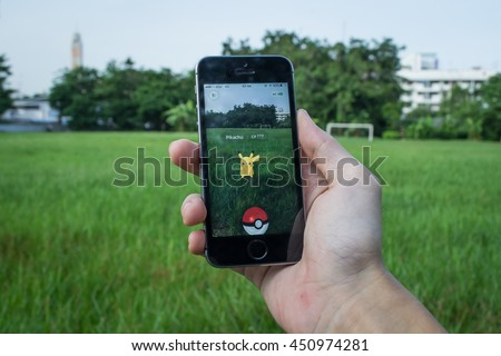 Bangkok, Thailand - July 12, 2016 : Apple iPhone5s held in one hand showing its screen with Pokemon Go application. - stock photo