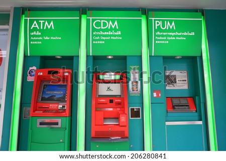 BANGKOK, THAILAND - JULY 18, 2014:  Bank Automatic Teller Machine (ATM) of Kasikornbank. Kasikornbank is the 3rd largest Thai banking found on 1945. - stock photo