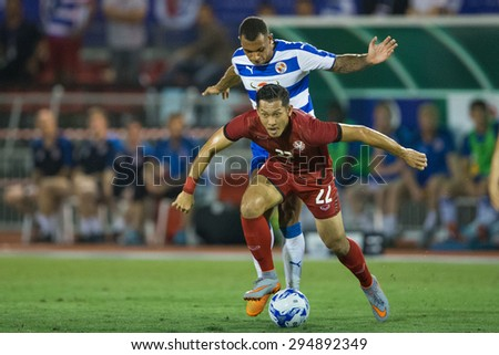 BANGKOK,THAILAND-July8:Chananan Pombupha(RED)of Thailand All Stars for the balln during The Reading FC Thailand Tour 2015 Thailand All Stars and Reading FC at National Stadium on July 8,2015,Thailand.