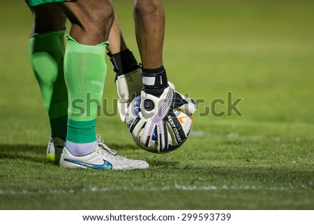 BANGKOK THAILAND-JULY 18:Football player man holding ball in during Thai Premier League BEC Tero Sasana F.C.and Muangthong Utd.at 72-years Anniversary Stadium on July 18, 2015,Thailand - stock photo