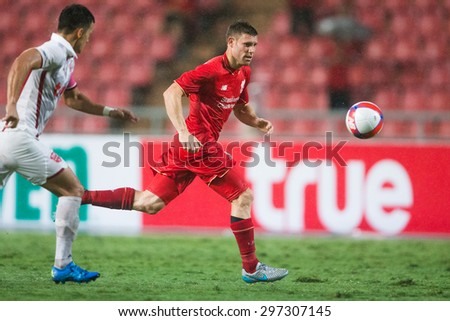 BANGKOK THAILAND JULY 14:James Milner (RED) of Liverpool in action during the international friendly match Thai All Stars and Liverpool FC at Rajamangala Stadium on July14,2015 in,Thailand. - stock photo