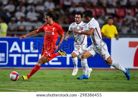 BANGKOK THAILAND JULY 14 :Lazar Markovic(RED)of Liverpool kicks the ball during the international friendly match Thai All Stars and Liverpool FC at Rajamangala Stadium on July14,2015 in,Thailand. - stock photo