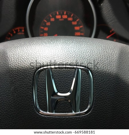 Bangkok, Thailand - July 1, 2017: Logo Honda on Black Steering Wheel and gauge, dashboard, instrument panel, speedometer. Honda is a Japanese multinational automotive manufacturing company. Close up.