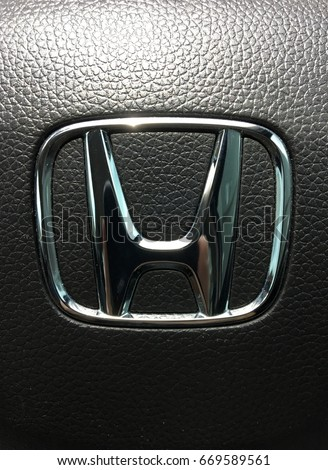 Bangkok, Thailand - July 1, 2017: Logo Honda on Black Steering Wheel. Honda is a Japanese multinational automotive manufacturing company. Closeup.