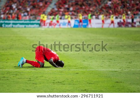 BANGKOK,THAILAND-JULY 14 : Mamadou Sakho of Liverpool in action during LFC Tour 2015 between Thai Premier League All Stars and Liverpool at Rajamangala Stadium on July 14,2015 in Bangkok,Thailand. - stock photo