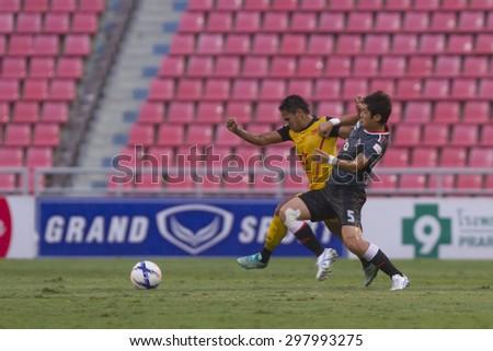 BANGKOK,THAILAND:JULY 2015:Murakami(blue)and Kritsada poses during football Thai Premier League between Osotspa M150 and Chiang Rai United at Rajamangala National Stadium on July 19,2015inThailand.  - stock photo