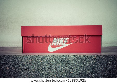 BANGKOK, THAILAND - JULY 2, 2017: Nike box shoes on stone floor,  Nike, Inc. is an American multinational corporation that designs, develops, manufactures and sells footwear and other items