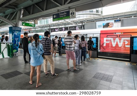 BANGKOK THAILAND - JULY 18 - People standing in lines waiting for BTS sky train at Asoke station on July 18, 2015 in Bangkok Thailand - stock photo