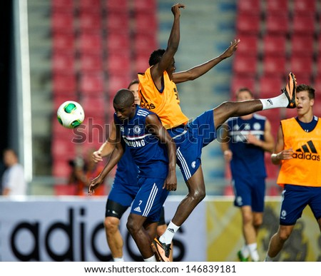 BANGKOK,THAILAND-JULY 16:  Ramires (L) of Chelsea FC in action during a Chelsea FC training session at Rajamangala Stadium on July 16, 2013 in Bangkok, Thailand.