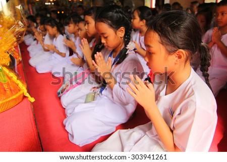 BANGKOK, THAILAND - JULY 29, 2015 : Student of Pieamsuwan school, Thai candle festival of buddha (The Buddhist Lent Day) in Bangkok, Thailand. - stock photo