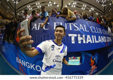 BANGKOK THAILAND-JULY15:Suphawut Thueanklang of Chonburi Bluewave selfie during AFC FUTSAL CLUB CHAMPIONSHIP 2016 Match Chonburi Bluewave and Vic Vipers FC at Bangkok Arena Stadium on July15,2016