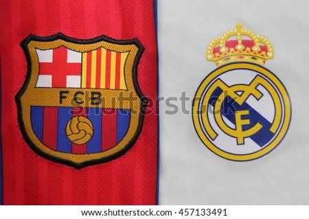 BANGKOK, THAILAND - JULY 24, 2016: The Logo of Barcelona and Real Madrid on Football Jerseys on July 24,2016 in Bangkok Thailand. - stock photo