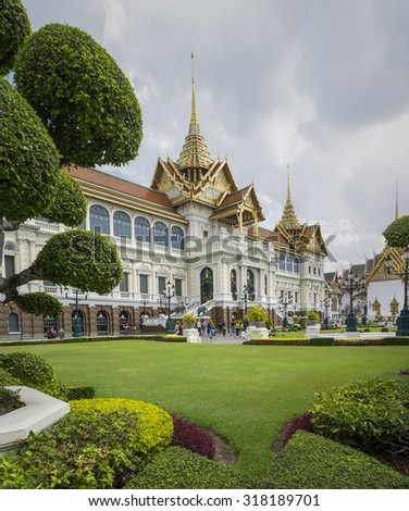 BANGKOK, THAILAND - JULY 11, 2015: Tourists tour around the Grand Palace in Bangkok, Thailand. (This is an important buddhist temple of Thailand and a famous tourist destination) - stock photo